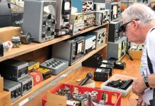 In this Sept. 18, 2016, photo, Joel Goldberg, of Newton, Mass., browses MIT's Radio Society flea market on the campus of the Massachusetts Institute of Technology in Cambridge, Mass.
