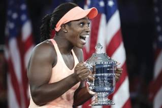 Sloane Stephens, of the United States, holds up the championship trophy after beating Madison Keys, of the United States, in the women's singles final of the U.S. Open tennis tournament, Saturday, Sept. 9, 2017, in New York.
