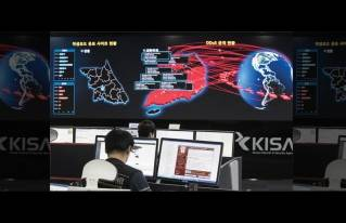 In this Monday, May 15, 2017, file photo, employees watch electronic boards to monitor possible ransomware cyberattacks at the Korea Internet and Security Agency in Seoul, South Korea. Unable to rely on good human behavior, computer security experts are developing software techniques to fight ransomware. But getting these protections in the hands of users is challenging.
