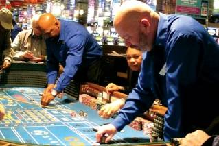 This April 20, 2018 photo shows a game of craps underway at Resorts Casino Hotel in Atlantic City, N.J. As Atlantic City's casinos mark their 40th anniversary, the industry is hailing the reopening of two of the five casinos that shut down since 2014, though some worry that re-expanding the market could lead to the same conditions that caused the closings in the first place.