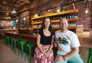 Abe and Heather Furth, two of the co-owners of Orono Brewing Company, sit inside their new location on State Street in Bangor on Monday, Aug. 29, 2016.