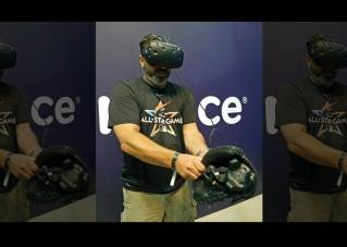 Andy Grabin takes off the catcher mitt with sensors after catching visual pitches at the All-Star FanFest in Miami Beach, Fla. Virtual Reality baseball is a hit at the All-Star FanFest in Miami. Fans get to feel what it's like to be the San Francisco Giants' Buster Posey catching without the pain of snatching major league pitches at 86-to-93 mph.