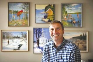 "In this Wednesday, Aug. 30, 2017 photo, L.L. Bean CEO Steve Smith poses in his office in Freeport, Maine. Smith is leading L.L. Bean's plan to sharpen its focus on inspiring its customers to ""Be an Outsider,"" to enjoy the outdoors with friends and family."