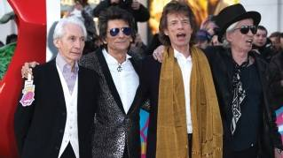 The Rolling Stones (from left: Charlie Watts, Ronnie Wood, Mick Jagger and Keith Richards) pose for photos upon arriving at the band's new art show Exhibitionism in London in April.