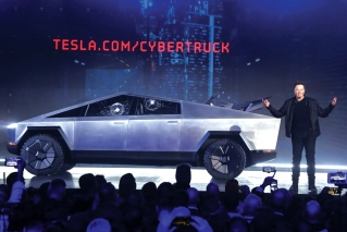 Stainless steel, broken glass and buzz, Tesla makes a pickup