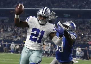 In this Dec. 26, 2016, file photo, Dallas Cowboys' Ezekiel Elliott (21) leaps into the end zone after getting past Detroit Lions' Tahir Whitehead, rear, for a touchdown in the second half of an NFL football game in Arlington, Texas. Elliott's immediate impact last season along with one of the strongest classes in years have made running backs popular again heading into this week's NFL draft.