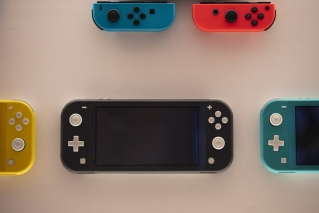In this Thursday, Jan, 23, 2020 file photo, Nintendo Switch game consoles are on display at Nintendo's official store in the Shibuya district of Tokyo. Time spent playing video games can be good for mental health, according to a new study by researchers at Oxford University. The finding comes as video game sales this year have boomed as more people are stuck at home because of the pandemic and many countries have once again imposed limits on public life. The paper released Monday, NOv. 16, 2020 is based on survey responses from people who played two games, Plants vs Zombies: Battle for Neighborville and Animal Crossing: New Horizons.