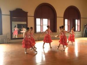 Dancers from Bangor Ballet rehearse in the grand ballroom in the Nichols Block.