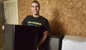 Mitch Newlin of Brunswick, a junior at Bates College in Lewiston, started a business that buys and sells used dorm refrigerators. Re-Fridge now serves 17 colleges and universities. (Photo by John Ewing/Portland Press Herald)