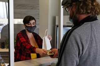 Marijuana is sold at Theory Wellness, a cannabis retail store, Thursday, Jan. 7, 2021, in South Portland, Maine. Cannabis has rocketed to the top of the state's agricultural crops, but the first few months of legal adult use sales have otherwise been without much fanfare.