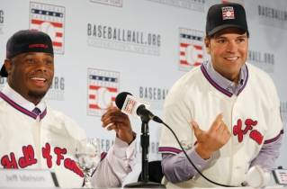 Retired Seattle Mariners outfielder Ken Griffey Jr., left, and retired New York Mets catcher Mike Piazza gesture to each other after Griffey donned his cap backwards and Piazza put his on facing forward at a press conference announcing their election to baseball's Hall of Fame, Thursday, Jan. 7, 2016, in New York. Both men were inducted into the Hall of Fame on Sunday.