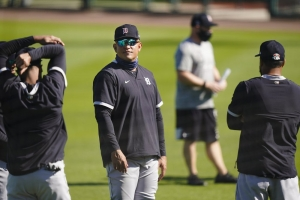 Detroit Tigers' Miguel Cabrera stands on the field with teammates during a spring training baseball workout Friday, Feb. 26, 2021, in Lakeland, Fla.