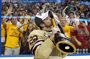 Boston College's Paul Carey kisses the National Championship trophy after the NCAA Frozen Four college hockey tournament final game against Ferris State Saturday, April 7, 2012, in Tampa, Fla. Boston College won 4-1 to claim the National Championship.