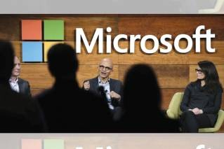 "In this Wednesday, Nov. 30, 2016, file photo, Microsoft CEO Satya Nadella, center, answers a question from the audience at the annual Microsoft shareholders meeting as Brad Smith, left, president and chief legal officer, and Amy Hood, chief financial officer, look on, in Bellevue, Wash. As Microsoft begins to talk more about its ambitions in advancing the next stage of artificial intelligence, some see the company's Bing search engine as the overlooked foundation to those efforts. Nadella describes Bing as a ""great training ground for building the hyper-scale, cloud-first services"" that have allowed the company to pivot to new technologies as its computer software business wanes."