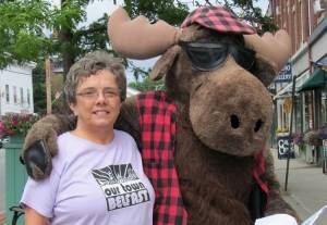Brodie the Moose (with OTB volunteer Marjie Byers) will return to this year's Belfast Bound Book Festival.