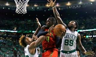 Atlanta Hawks forward Paul Millsap (4) drives to the hoop against Boston Celtics guard Marcus Smart, left, and forward Jae Crowder (99) during the first quarter in Game 6 of a first-round NBA basketball playoff series Thursday, April 28, 2016, in Boston. The Celtics lost the game 104-92, which ended their season. (AP Photo by Elise Amendola)