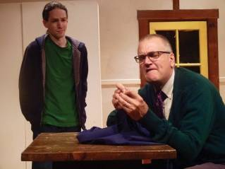 "Zack (Padraic Harrison, left) looks on as his father Joseph (Ron Lisnet) threads a needle in the Ten Bucks Theatre Company's production of ""Tigers Be Still."""