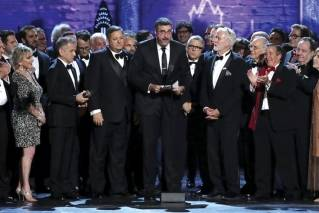 "Orin Wolf, center, and the cast and crew of ""The Band's Visit"" accept the award for best musical at the 72nd annual Tony Awards at Radio City Music Hall on Sunday, June 10, 2018, in New York."