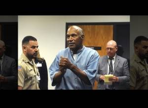 Former NFL football star O.J. Simpson reacts after learning he was granted parole at Lovelock Correctional Center in Lovelock, Nev., on Thursday, July 20, 2017. Simpson was convicted in 2008 of enlisting some men he barely knew, including two who had guns, to retrieve from two sports collectibles sellers some items that Simpson said were stolen from him a decade earlier.